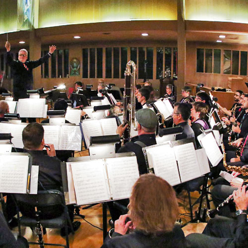 Pete Nowlen conducts the concert band during a performance