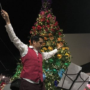 Mike Wong conducts the pep band at the Castro Street tree lighting ceremony